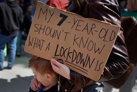 """A protestor holds a sign during a """"March For Our Lives"""" demonstration demanding gun control in Sacramento, California, U.S. March 24, 2018.  REUTERS/Bob Strong"""