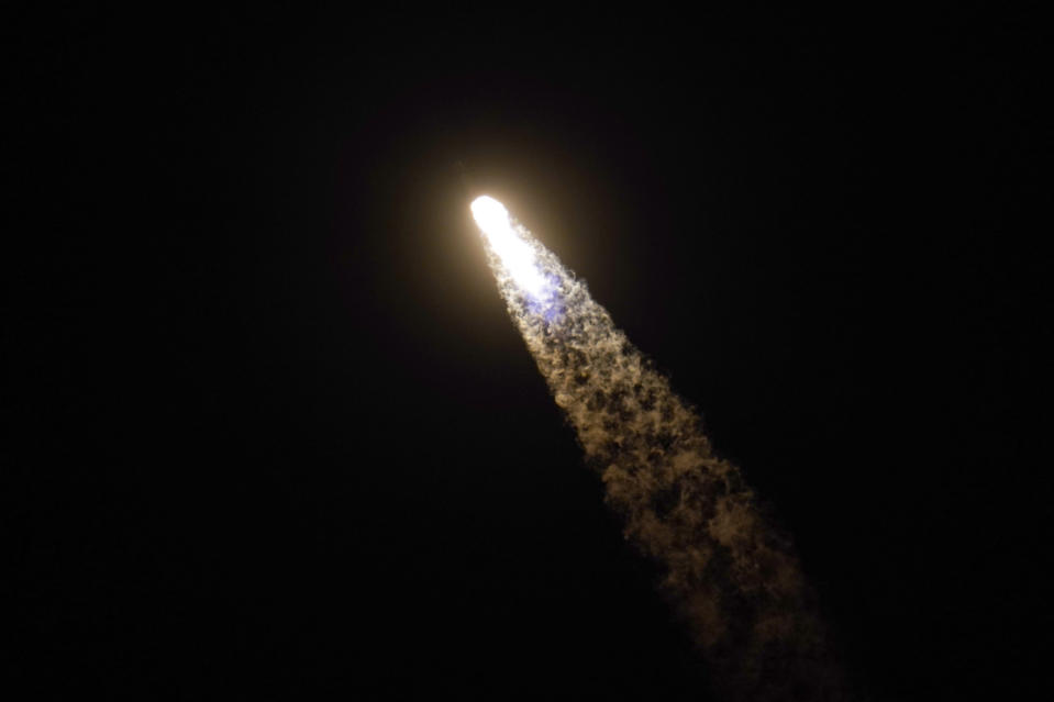 A SpaceX Falcon 9 rocket with the Crew Dragon space capsule leaves a trail of smoke as it lifts off from pad 39A at the Kennedy Space Center in Cape Canaveral, Fla., Friday, April 23, 2021. (AP Photo/John Raoux)