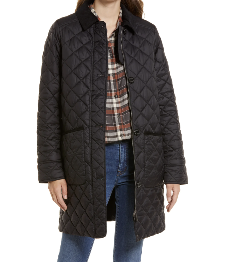 model posing in black Barbour Hollingworth Quilted Jacket wearing jean and a plaid shirt