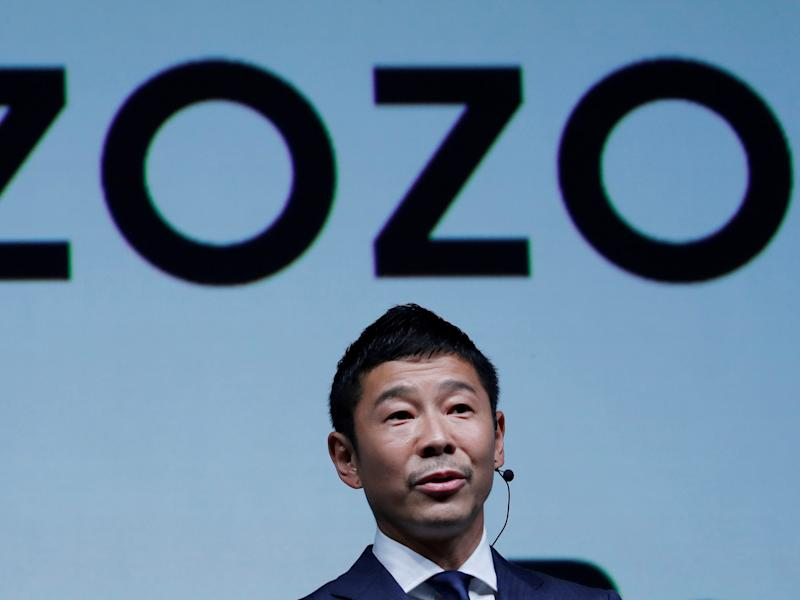 FILE PHOTO : Yusaku Maezawa, the chief executive of Zozo, which operates Japan's popular fashion shopping site Zozotown and is officially called Start Today Co, speaks at an event launching the debut of its formal apparel items, in Tokyo, Japan, July 3, 2018. REUTERS/Kim Kyung-Hoon/File Photo