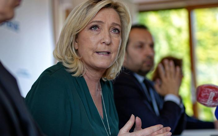 Latest polling shows that Ms Le Pen would beat Emmanuel Macron by two points in the first round of next year's presidential elections. - Getty