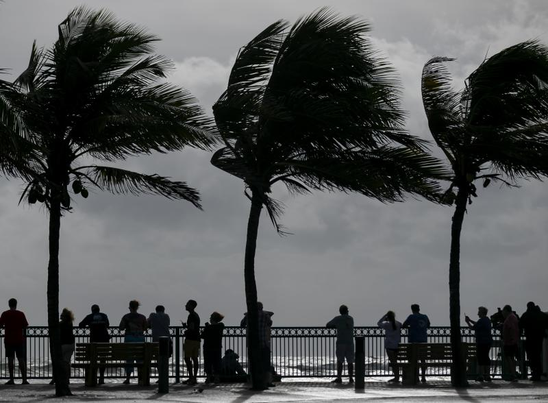 Beach goers in Sexton Plaza watch the waves crash onto Vero Beach as Hurricane Dorian inches closer to Florida's Treasure Coast on Monday, Sept. 2, 2019. (Photo: Matias J. Ocner/Miami Herald/Tribune News Service via Getty Images)