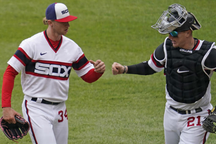 Chicago White Sox starting pitcher Michael Kopech, left, celebrates with catcher Zack Collins as they walk to the dugout after the fifth inning of a baseball game against the Texas Rangers in Chicago, Sunday, April 25, 2021. (AP Photo/Nam Y. Huh)