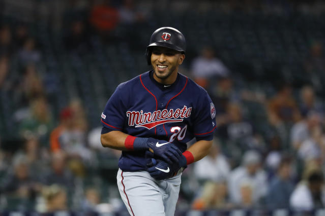 Minnesota Twins' Eddie Rosario smiles at the dugout after walking in the fourth inning of a baseball game against the Detroit Tigers in Detroit, Tuesday, Sept. 24, 2019. (AP Photo/Paul Sancya)
