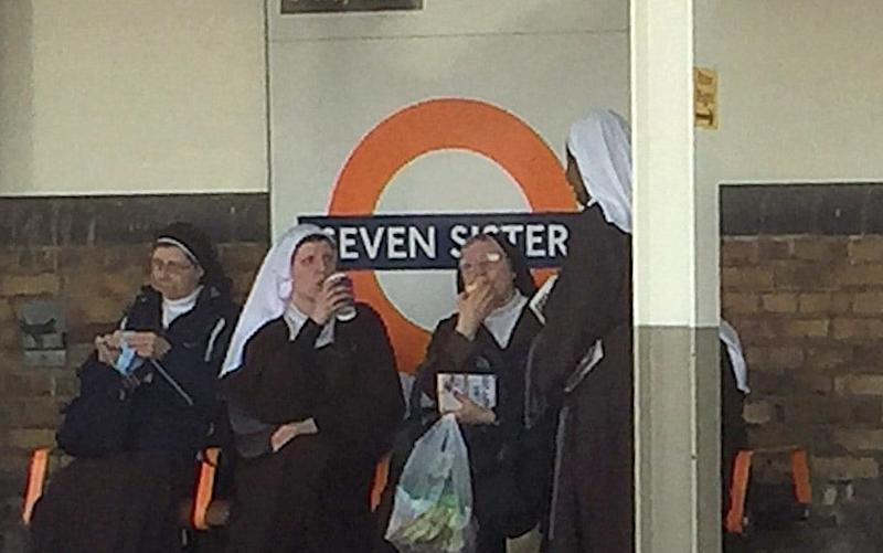 Carmelite nuns at Seven Sisters station  - Credit: Ben Patey / SWNS.com