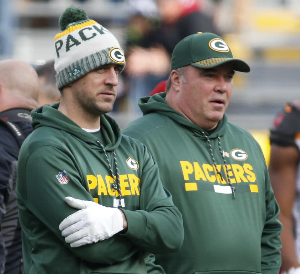 Packers quarterback Aaron Rodgers, pictured with head coach Mike McCarthy before Green Bay's Week 13 win over visiting Tampa Bay, was a spectator for the sixth time since suffering a collarbone injury against Minnesota on Oct. 15. (AP)