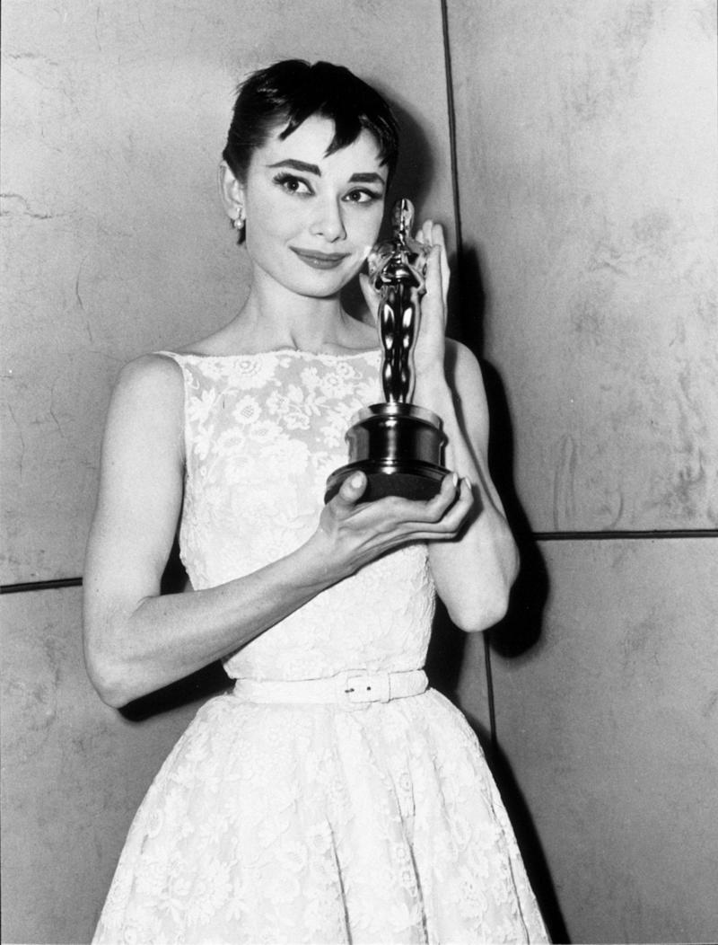 ThisOscars dress has inspired the cut and fabric of countless dresses in the decades since Hepburn wore it to the Academy Awards. Made by the young designer Hubert De Givenchy, who went on to found the house of Givenchy. Hepburn continued to wear his dresses for the next seven films she made. Relationship goals.