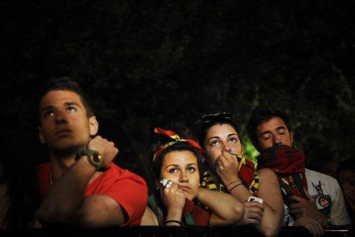 Portuguese football fans react at the end of the Euro 2012 Championships football match between Spain and Portugal at Campo Pequeno Square in Lisbon. Defending champions Spain beat Portugal 4-2 on penalties after their Euro 2012 semi-final finished 0-0 after extra-time