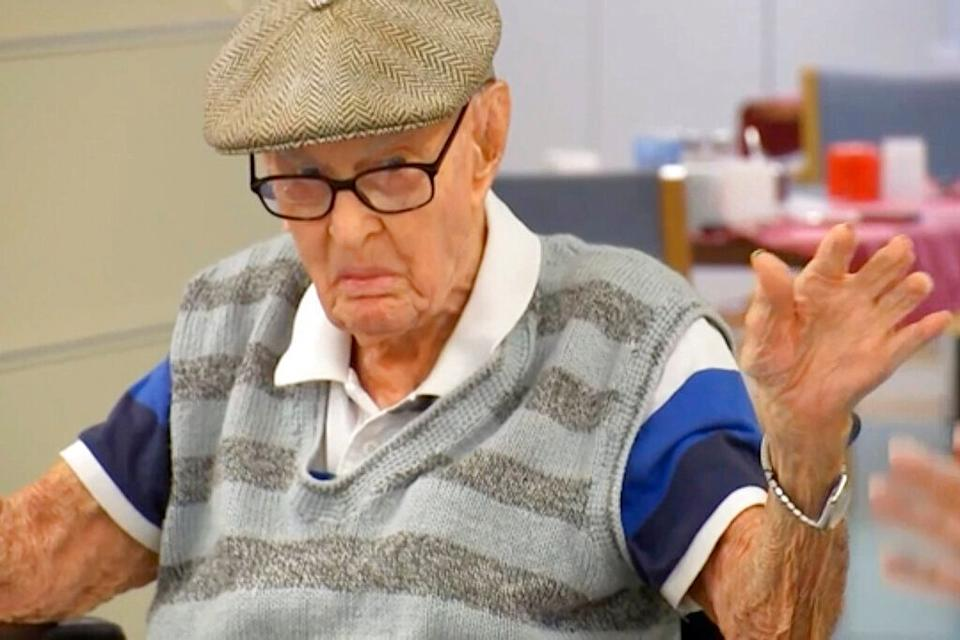 Australia's Dexter Kruger gestures at a nursing home in the rural Queensland state town of Roma, Australia on May 13, 2021.  Kruger, Australia's oldest-ever man, has included eating chicken brains among his secrets to living more than 111 years. The retired cattle rancher on Monday, May 17, 2021, marked 124 days since he turned 111, a day older than World War I veteran Jack Lockett was when he died in 2002. (Australian Broadcasting Corporation via AP) (Photo:  via AP)