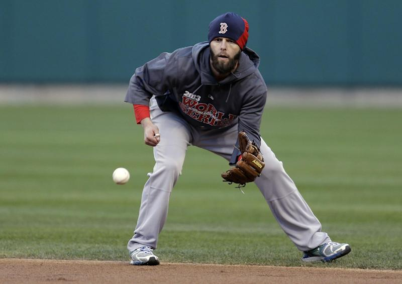 Boston Red Sox second baseman Dustin Pedroia handles a grounder during baseball practice Friday, Oct. 25, 2013, in St. Louis. The Red Sox and St. Louis Cardinals are set to play Game 3 of the World Series on Saturday in St. Louis. (AP Photo/Jeff Roberson)