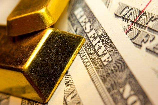 US Dollar Strength Leads Currencies to Break Key Levels, Gold Tumbles Below $1300