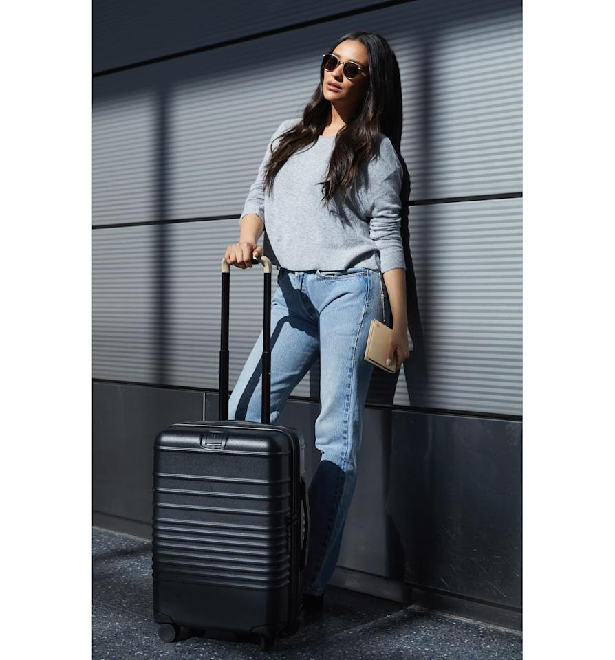"<p>This <a href=""https://www.popsugar.com/buy/B%C3%A9-21-Inch-Rolling-Spinner-Suitcase-538699?p_name=B%C3%A9is%2021-Inch%20Rolling%20Spinner%20Suitcase&retailer=shop.nordstrom.com&pid=538699&price=198&evar1=fab%3Aus&evar9=45654068&evar98=https%3A%2F%2Fwww.popsugar.com%2Fphoto-gallery%2F45654068%2Fimage%2F47089843%2FB%C3%A9is-21-Inch-Rolling-Spinner-Suitcase&list1=shopping%2Ctravel%2Cbags%2Cluggage%2Csuitcases%2Ctravel%20style%2Cbest%20of%202020&prop13=api&pdata=1"" rel=""nofollow"" data-shoppable-link=""1"" target=""_blank"" class=""ga-track"" data-ga-category=""Related"" data-ga-label=""https://shop.nordstrom.com/s/beis-21-inch-rolling-spinner-suitcase/5318785/full?origin=keywordsearch-personalizedsort&amp;breadcrumb=Home%2FAll%20Results&amp;color=black"" data-ga-action=""In-Line Links"">Béis 21-Inch Rolling Spinner Suitcase</a> ($198) is suitable for both international and domestic carry on. </p>"
