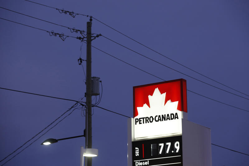 A Petro-Canada sign displays the price of unleaded gas at 77.9 cents CAD (55.7 cents USD) per litre in Ottawa, Canada, January 29, 2016. To match Wider Image/Global Oil price. REUTERS/Chris Wattie