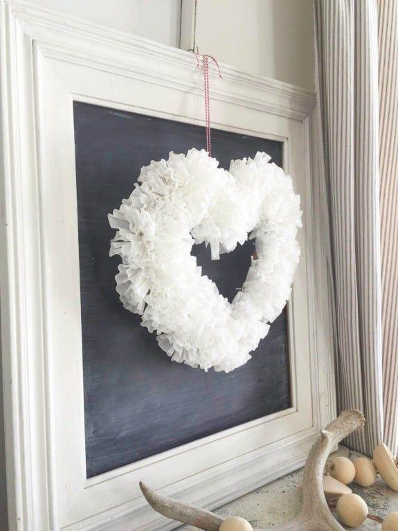 """<p>It's hard to believe, but this fluffy, fantastic wreath was easily made by pulling coffee filters through holes in a heart made of cardboard. </p><p><strong>Get the tutorial at <a href=""""https://overthebigmoon.com/diy-coffee-filter-valentines-wreath/"""" rel=""""nofollow noopener"""" target=""""_blank"""" data-ylk=""""slk:Over the Big Moon"""" class=""""link rapid-noclick-resp"""">Over the Big Moon</a>.</strong></p><p><a class=""""link rapid-noclick-resp"""" href=""""https://www.amazon.com/8-12-Basket-Coffee-Filters-White/dp/B07MSGDPR2?tag=syn-yahoo-20&ascsubtag=%5Bartid%7C10050.g.35057743%5Bsrc%7Cyahoo-us"""" rel=""""nofollow noopener"""" target=""""_blank"""" data-ylk=""""slk:SHOP COFFEE FILTERS"""">SHOP COFFEE FILTERS</a><br></p>"""