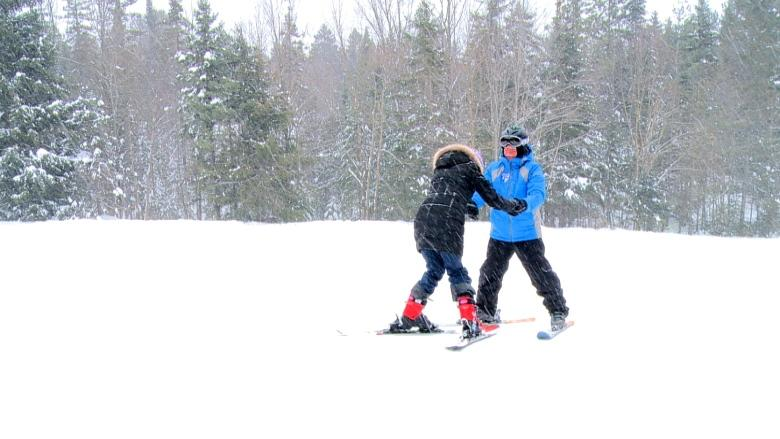Newly arrived Syrian family embraces first Canadian winter by hitting the slopes