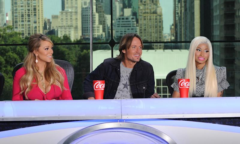 """FILE - This Sept. 17, 2012 file image released by Fox shows the new judges for the singing competition series, """"American Idol,"""" from left, Mariah Carey, Keith Urban and Nicki Minaj and during a news conference in New York. (AP Photo/FOX, Michael Becker)"""