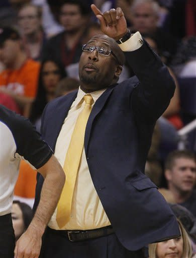 Los Angeles Lakers head coach Mike Brown instructs his team against the Phoneix Suns during the first half of an NBA basketball game, Saturday, April 7, 2012, in Phoenix. (AP Photo/Matt York)
