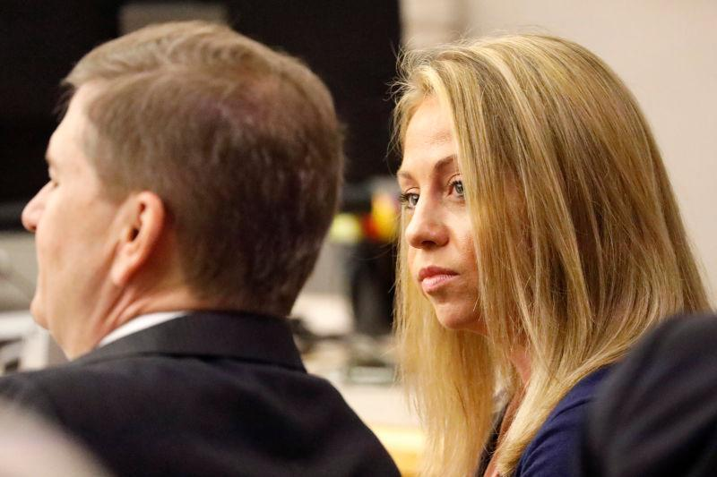 Fired Dallas police officer Amber Guyger looks toward her attorney before proceedings in her murder trial in Dallas