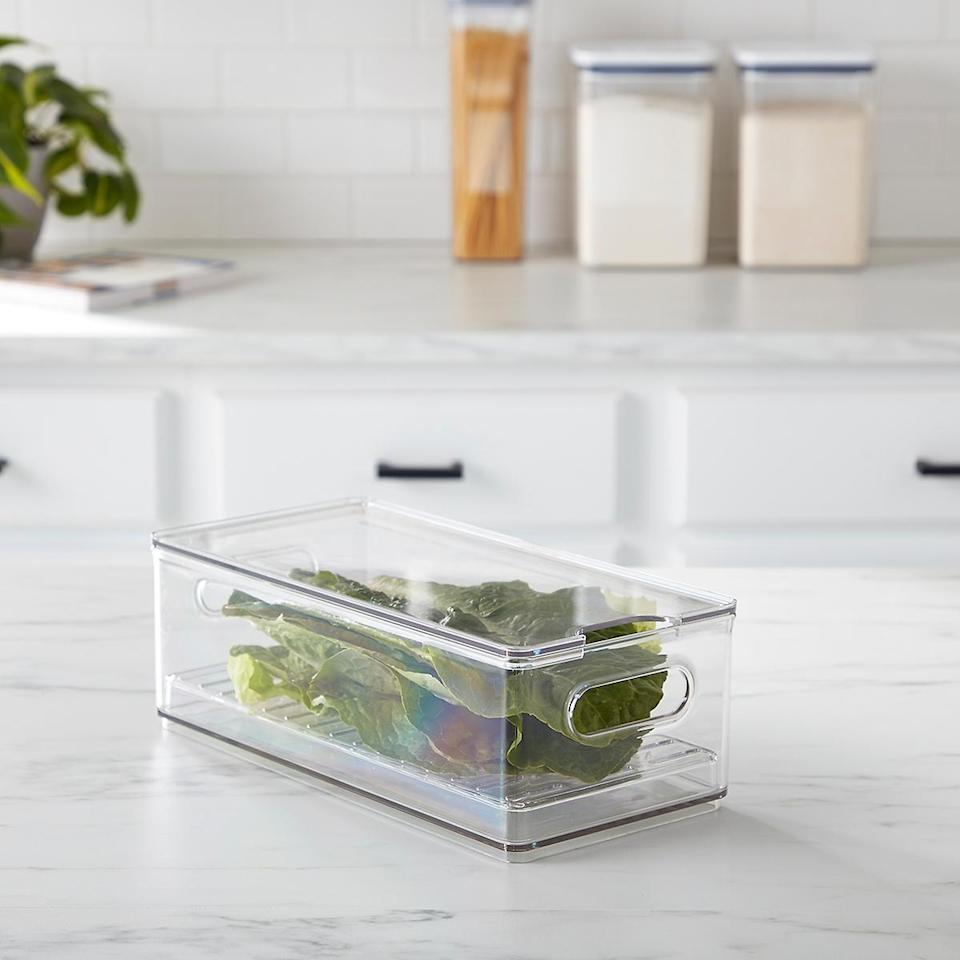 "<h2>The Home Edit Produce Bin</h2><br>Each bin helps to keep moisture away from produce, maintaining the freshness of fruits and veggies.<br><br><strong>The Home Edit</strong> The Home Edit Produce Bin, $, available at <a href=""https://go.skimresources.com/?id=30283X879131&url=https%3A%2F%2Fwww.containerstore.com%2Fs%2Fstorage%2Fstorage-the-home-edit-collection%2Fthe-home-edit-kitchen-pantry-collection%2Fthe-home-edit-produce-bin%2F123d%3FproductId%3D11012904"" rel=""nofollow noopener"" target=""_blank"" data-ylk=""slk:The Container Store"" class=""link rapid-noclick-resp"">The Container Store</a>"