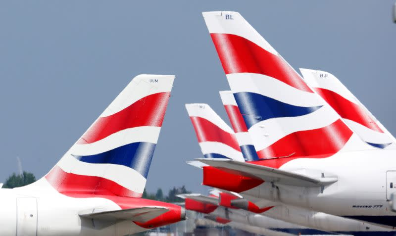 FILE PHOTO: British Airways tail fins are pictured at Heathrow Airport in London