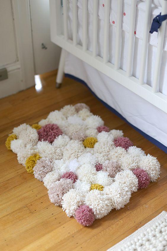"<p>What could be better than a fluffy and stylish pom pom rug?  [<i><a href=""https://uk.pinterest.com/pin/366480488406944709/"">Photo: Pinterest]</a></i></p>"