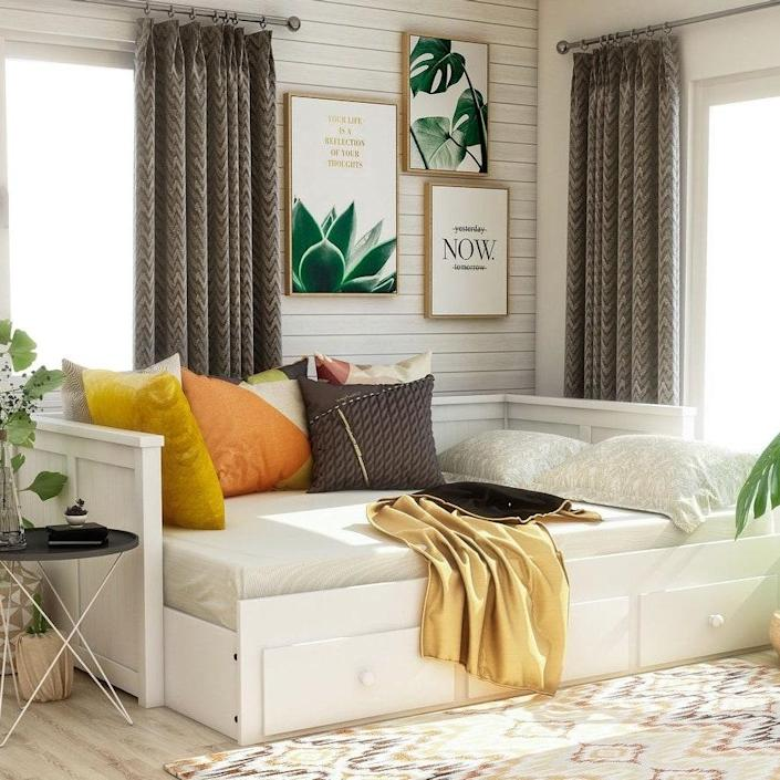 "<p>This lovely <a href=""https://www.architecturaldigest.com/gallery/daybeds-that-prove-space-saving-can-be-sophisticated?mbid=synd_yahoo_rss"" rel=""nofollow noopener"" target=""_blank"" data-ylk=""slk:daybed"" class=""link rapid-noclick-resp"">daybed</a> is another one of our favorite contemporary storage beds. It's perfect for a guest room, TV room, or teen's room. Find it in black or white.</p> <p><strong>Sizes available:</strong> Full</p> <p><strong>Stars:</strong> 4.5 out of 5</p> <p><strong>Customer Review:</strong> ""This full-size daybed is the perfect size to fit into a <a href=""https://www.architecturaldigest.com/gallery/best-beds-for-small-rooms?mbid=synd_yahoo_rss"" rel=""nofollow noopener"" target=""_blank"" data-ylk=""slk:small bedroom"" class=""link rapid-noclick-resp"">small bedroom</a>, not to mention how light and airy it makes the bedroom feel. Was skeptical at first to buy since it did need to be put together, but loved this piece from the first time I saw it, so I took the plunge. The daybeds I've seen in the stores cannot compare to the style and price of this little gem! Have never been happier with my decision!"" —<em>Terri</em></p> $691, Overstock. <a href=""https://www.overstock.com/Home-Garden/Ophelia-Contemporary-Full-Black-Storage-Daybed-by-FOA/20831128/product.html"" rel=""nofollow noopener"" target=""_blank"" data-ylk=""slk:Get it now!"" class=""link rapid-noclick-resp"">Get it now!</a>"