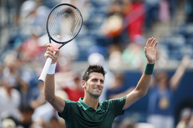 Novak Djokovic, of Serbia, celebrates after defeating Mirza Basic, of Bosnia, during the Rogers Cup men's tennis tournament in Toronto, Tuesday, Aug. 7, 2018. (Mark Blinch/The Canadian Press via AP)