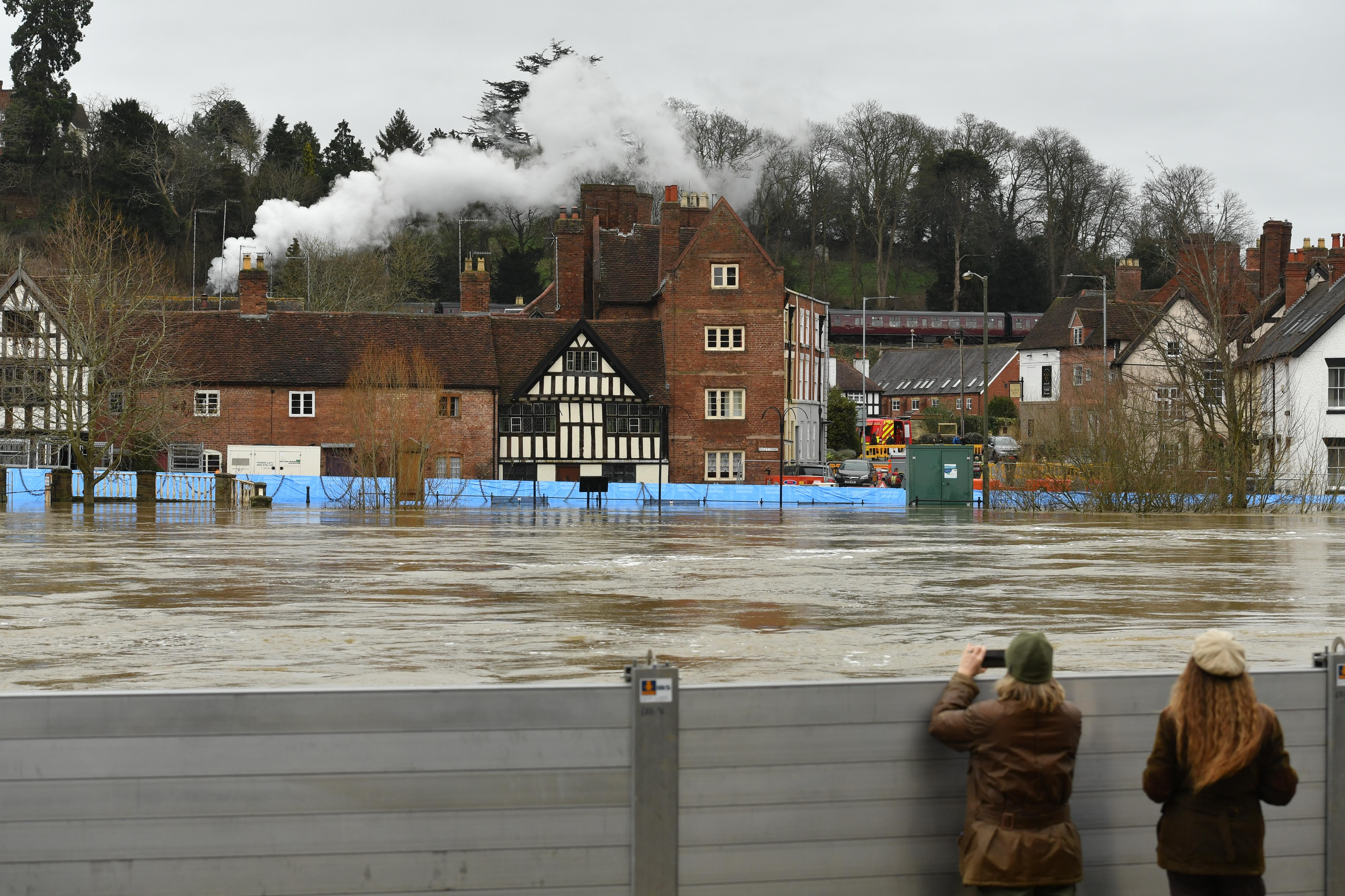 A steam train on the Severn Valley Railway passes the town of Bewdley, Worcestershire, in the aftermath of Storm Dennis.