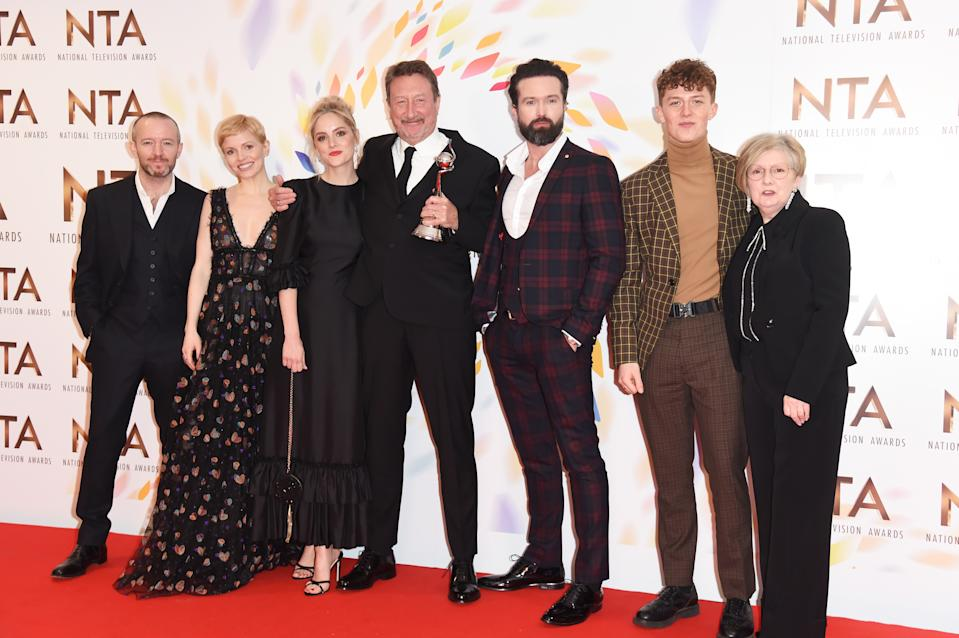 """Anthony Byrne, Kate Phillips, Sophie Rundle, Steven Knight, Emmett J. Scanlan, Harry Kirton and guest, accepting the Best Drama award for """"Peaky Blinders"""", pose in the winners room at the National Television Awards 2020 at The O2 Arena on January 28, 2020 in London, England. (Photo by David M. Benett/Dave Benett/Getty Images)"""