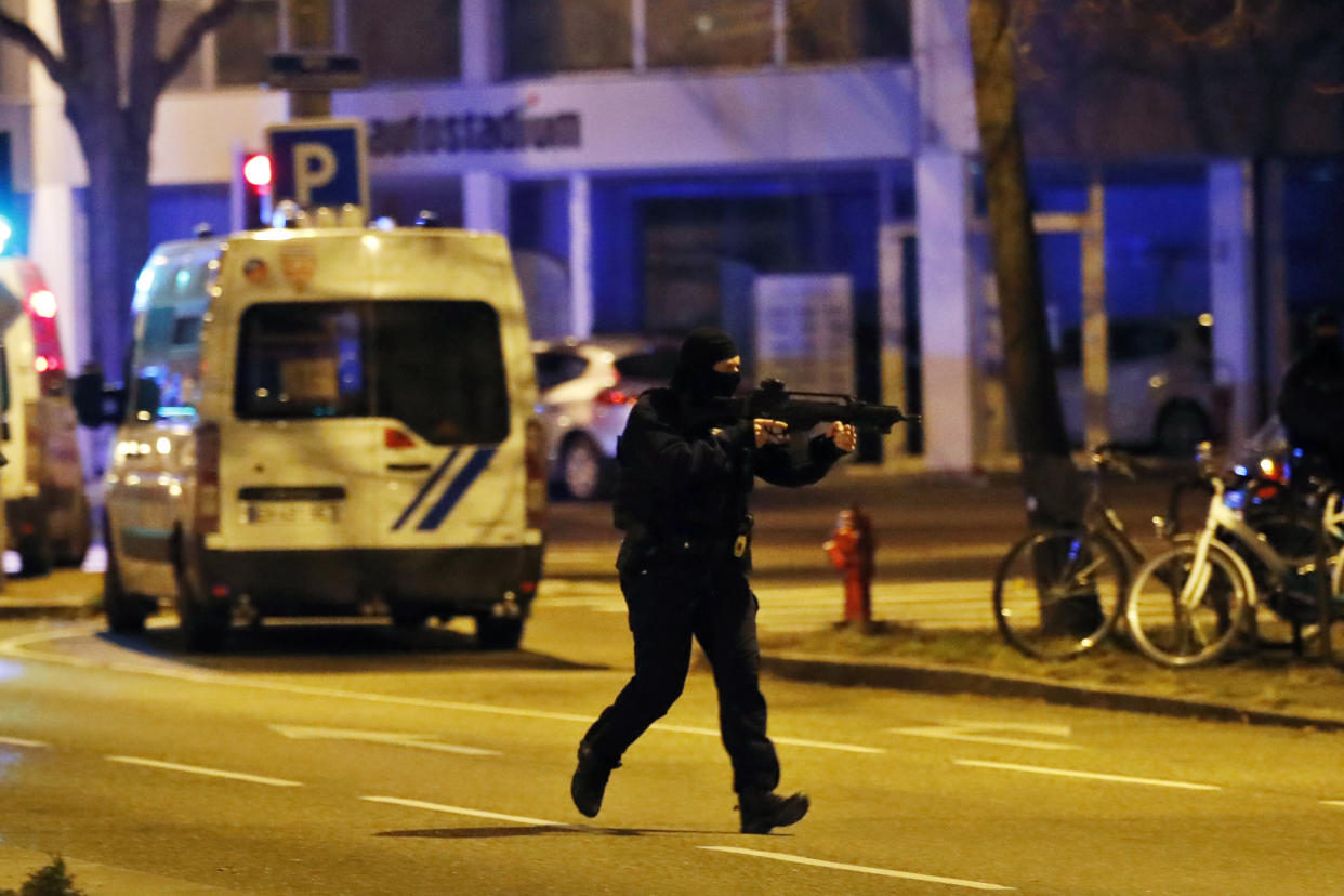 A French police officer runs during an operation, in Strasbourg, eastern France, Thursday, Dec. 13, 2018. (Photo: Christophe Ena/AP)