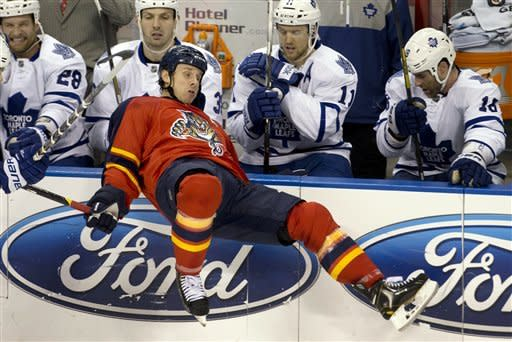 Florida Panthers' Stephen Weiss falls in front of the Toronto Maple Leafs bench during the first period of an NHL hockey game in Sunrise, Fla., Monday, Feb. 18, 2013. (AP Photo/J Pat Carter)