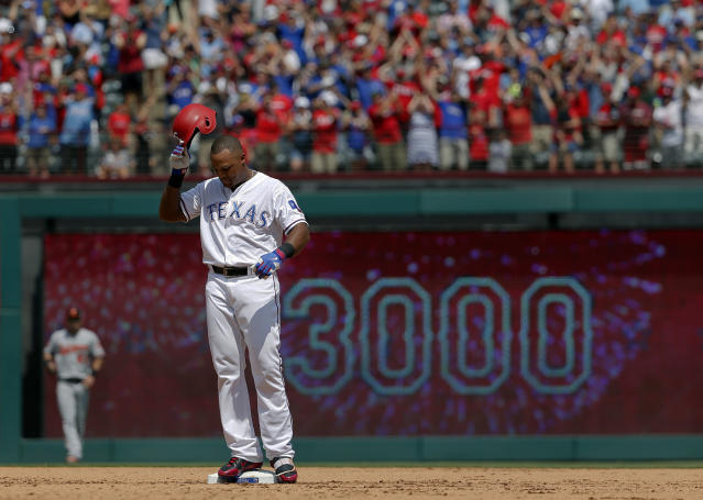 FILE - In this July 30, 2017, file photo, Texas Rangers' Adrian Beltre holds his helmet as he acknowledges cheers from fans after hitting a double for his 3,000th career hit that came off a pitch from Baltimore Orioles' Wade Miley in the fourth inning of a baseball game in Arlington, Texas. (AP Photo/Tony Gutierrez, File)