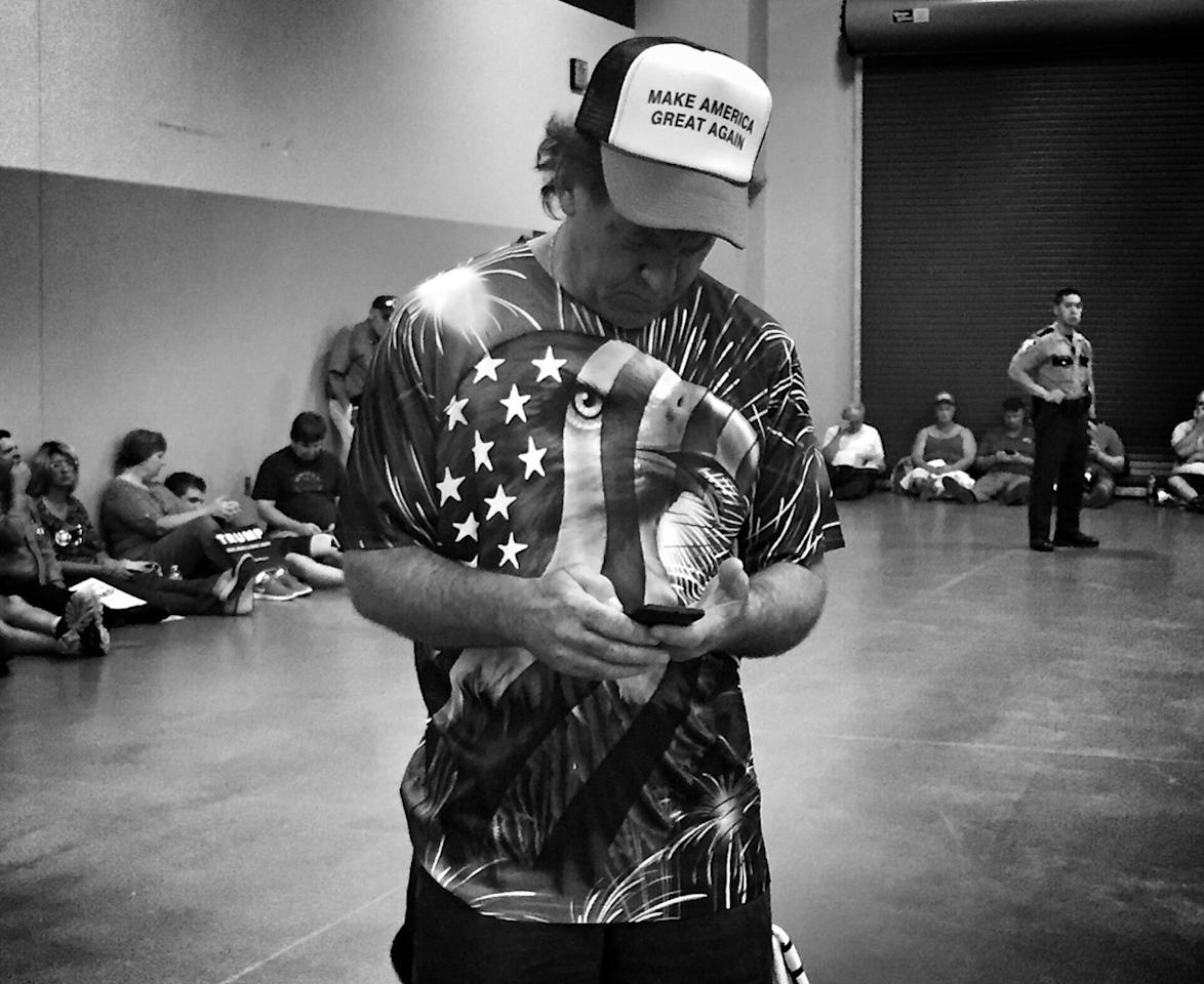 <p>A Trump supporter in a patriotic shirt at a campaign rally, July 6, Cincinnati, Ohio. (Photo: Holly Bailey/Yahoo News) </p>