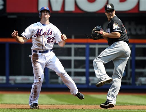New York Mets' Mike Baxter, left, reacts after being tagged out by Miami Marlins second baseman Nick Green during a double play in the first inning of a baseball game, Thursday, Aug. 9, 2012, at Citi Field in New York. Daniel Murphy was out at first. (AP Photo/Seth Wenig)