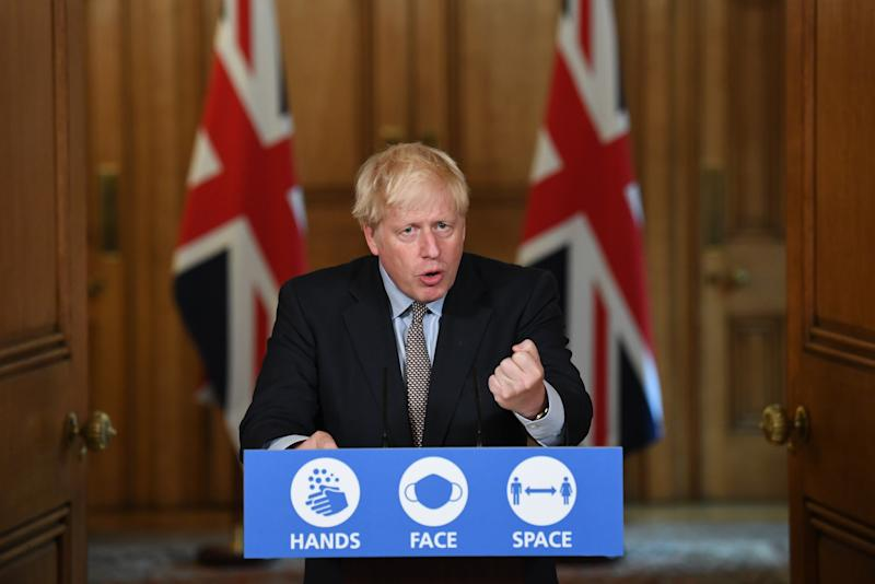 Prime Minister Boris Johnson during a virtual press conference at Downing Street, London, following the announcement that the legal limit on social gatherings is set to be reduced from 30 people to six. The change in the law in England will come into force on Monday as the Government seeks to curb the rise in coronavirus cases.