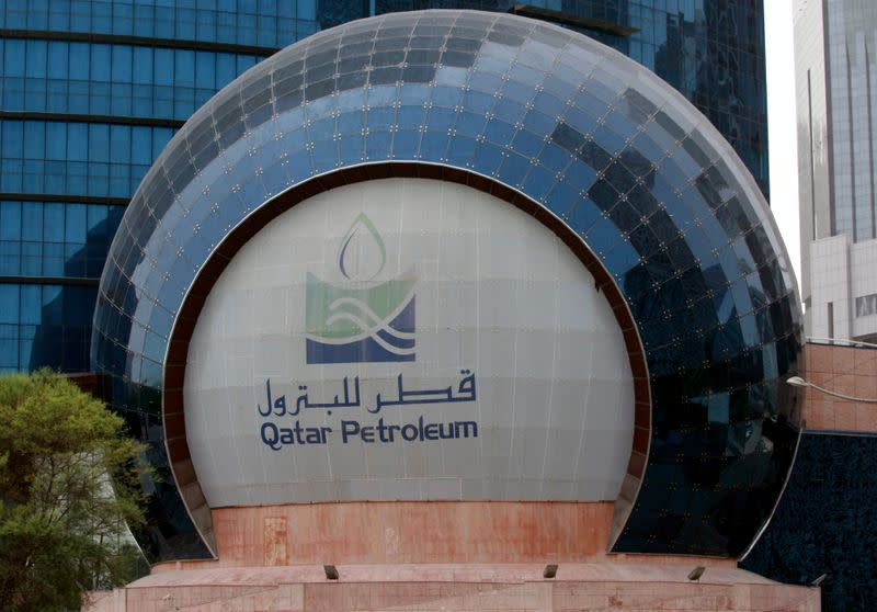 FILE PHOTO: The logo of Qatar Petroleum is seen at its headquartes in Doha