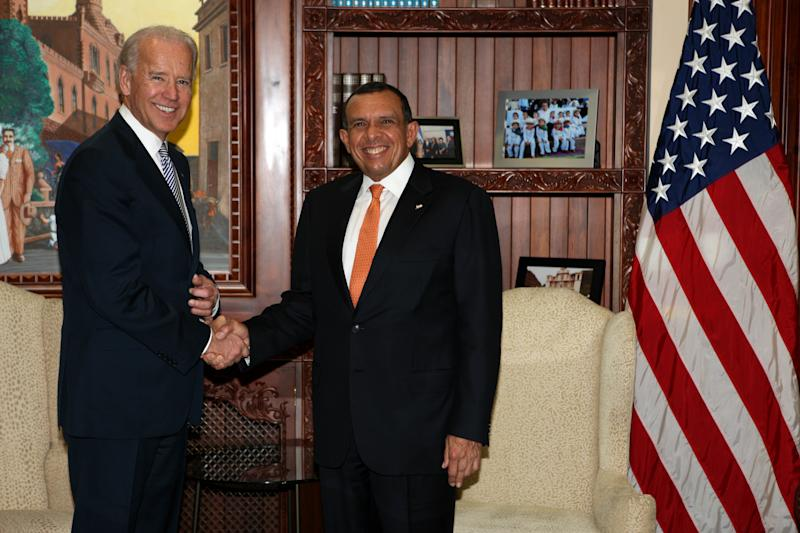 Vice President Joe Biden, left, shakes hands with Honduras President Porfirio Lobo upon his arrival to Presidential House in Tegucigalpa, Honduras, Tuesday March, 6, 2012. Biden is on a one-day official visit to Honduras. Biden's two-day trip to Mexico and Honduras comes amid calls by many of the region's leaders to discuss decriminalizing drugs as a way to ease a vicious war on cartels that has left Latin America bloodied. (AP Photo/Wilfredo Valladares, Honduras Presidential House)