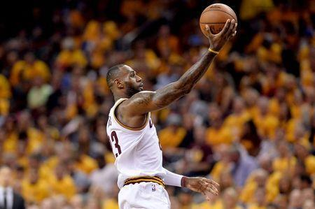 May 19, 2016; Cleveland, OH, USA; Cleveland Cavaliers forward LeBron James (23) shoots the ball during the second half against the Toronto Raptors in game two of the Eastern conference finals of the NBA Playoffs at Quicken Loans Arena. The Cavaliers won 108-89. Mandatory Credit: Ken Blaze-USA TODAY Sports