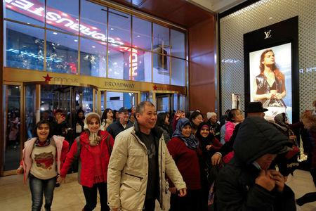 People enter the Broadway entrance of Macy's Herald Square in Manhattan, New York. REUTERS/Andrew Kelly