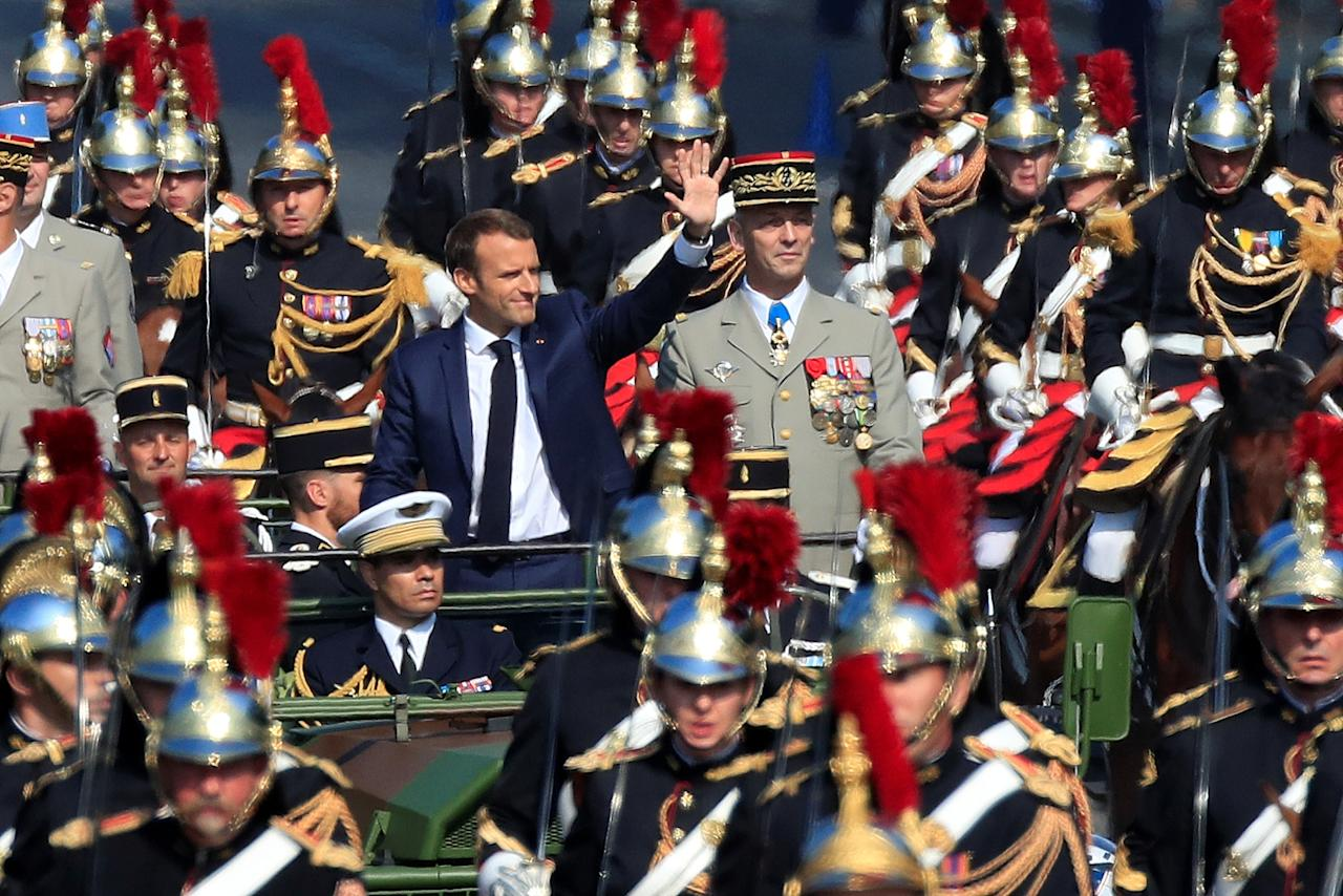 <p>French President Emmanuel Macron and Chief of the French Army Defense Staff Gen. Francois Lecointre arrive in a command car for the traditional Bastille Day military parade on the Champs-Élysées in Paris, France, July 14, 2018. (Photo: Gonzalo Fuentes/Reuters) </p>