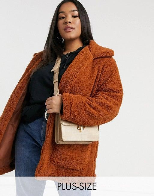 """<br><br><strong>Brave Soul Plus</strong> Teddy Borg Jacket, $, available at <a href=""""https://www.asos.com/brave-soul-plus/brave-soul-plus-heavenly-teddy-borg-jacket-in-ginger/prd/22017616?colourwayid=60343480&SearchQuery=plus%20size%20shearling"""" rel=""""nofollow noopener"""" target=""""_blank"""" data-ylk=""""slk:ASOS"""" class=""""link rapid-noclick-resp"""">ASOS</a>"""