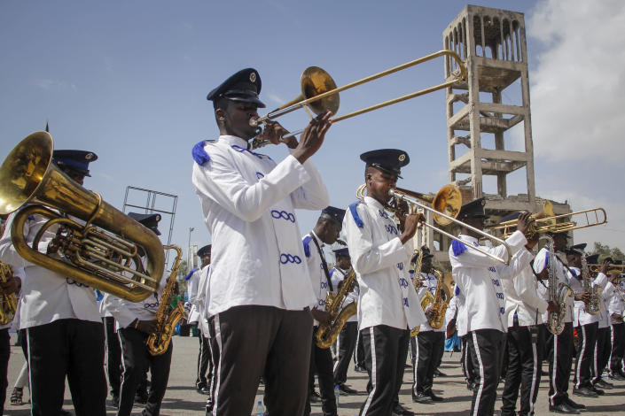 A band plays music at a demonstration supporting a resolution to allocate 13 seats to the Banadir region which encompasses the capital, in effect expanding the Senate, in Mogadishu, Somalia Friday, Jan. 29, 2021. As Somalia marks three decades since a dictator fell and chaos engulfed the country, the government is set to hold a troubled national election but two regional states are refusing to take part in the vote to elect Somalia's president and time is running out before the Feb. 8 date on which mandates expire. (AP Photo/Farah Abdi Warsameh)