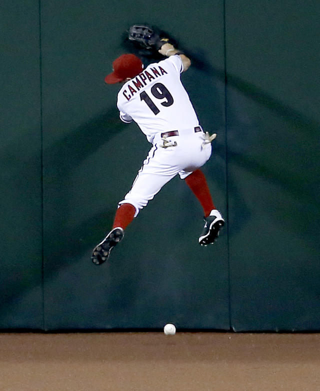 Arizona Diamondbacks' Tony Campana can't catch an RBI triple hit by Toronto Blue Jays' Anthony Gose during the second inning of a baseball game, Monday, Sept. 2, 2013, in Phoenix. (AP Photo/Matt York)