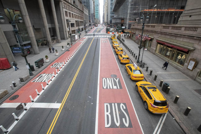 Yellow cabs line an empty 42nd Street in New York as the number of people taken to hospital with COVID-19 rose faster than expected. (AP)
