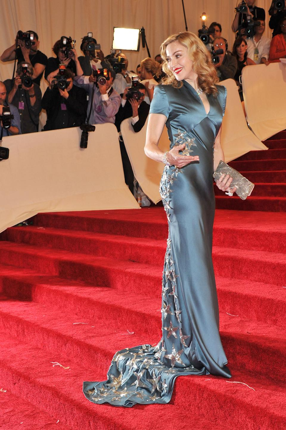 """<h1 class=""""title"""">Madonna in Stella McCartney, 2011</h1><cite class=""""credit"""">Photo: Getty Images</cite>"""
