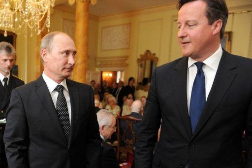 British Prime Minister David Cameron (R) and Russian President Vladimir Putin at 10 Downing Street on June 16, 2013