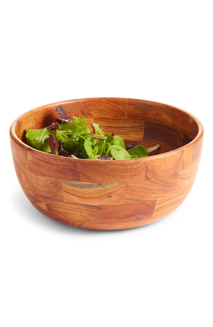 """This wood bowl has a great shape and color, and is perfect as a party piece or for fruit storage. $65, Nordstrom. <a href=""""https://www.nordstrom.com/s/nordstrom-at-home-large-wood-serving-bowl/5226425"""" rel=""""nofollow noopener"""" target=""""_blank"""" data-ylk=""""slk:Get it now!"""" class=""""link rapid-noclick-resp"""">Get it now!</a>"""