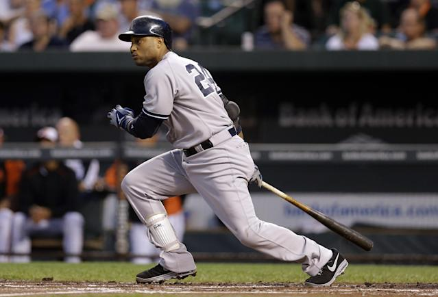 New York Yankees' Robinson Cano watches his ground out in the first inning of a baseball game against the Baltimore Orioles, Wednesday, Sept. 11, 2013, in Baltimore. Brett Gardner scored on the play. (AP Photo/Patrick Semansky)