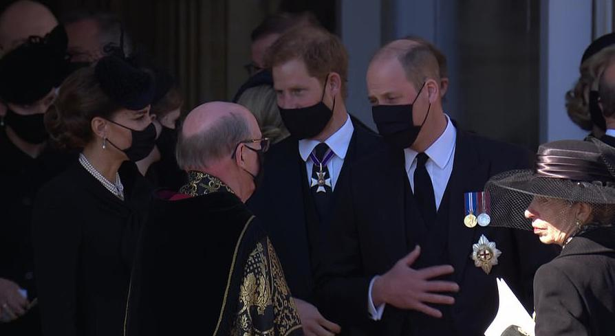 Kate Middleton and Prince Harry talking at Prince Philip's funeral
