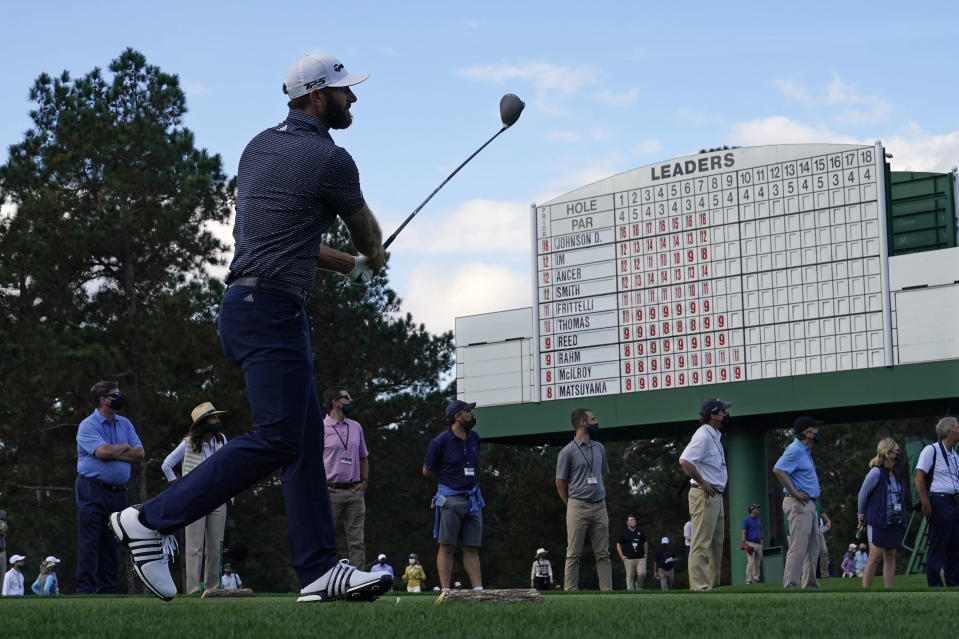 Dustin Johnson follows his tee shot on the eighth hole during the final round of the Masters golf tournament Sunday, Nov. 15, 2020, in Augusta, Ga. (AP Photo/David J. Phillip)